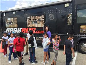 Fourth grade students boarding the Geekbus