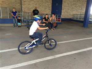 SAPD Judges Bicycle Riding Rodeo at Five Palms ES