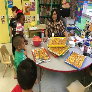 Kindred Elementary pre-kindergarten students made donuts