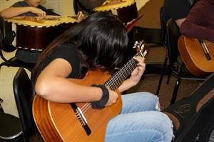 Student learning to play guitar