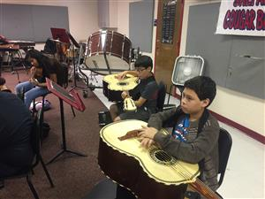 Students learning how to play instruments in a group