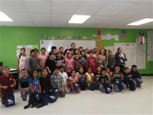 Jairo Lozano taking a picture with students